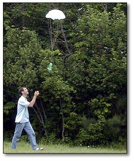 1st Launch with Parachute Water bottle rocket with a parachute made of bin liner. Opens bit too late and the nose cone protecting the parachute needs to be attached better